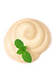 Mayonnaise swirl with a mint leaf  on a white background close-up. Top view Royalty Free Stock Photo