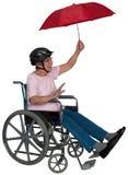 Mayor activo feliz de la silla de ruedas aislado Foto de archivo libre de regalías