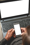 Mayor con el teléfono y el ordenador portátil Imágenes de archivo libres de regalías