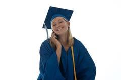 Mayor de graduación en el teléfono Imagenes de archivo