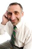 Mayor del hombre de negocios en el teléfono celular imagen de archivo