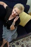 Mayor en el teléfono celular Imagen de archivo libre de regalías