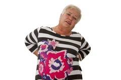 Mayor femenino con dolor de espalda Imagen de archivo libre de regalías