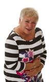 Mayor femenino con dolor de estómago Fotos de archivo libres de regalías