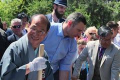 Mayor of Kiev Vitali Klitschko and Mayor of Kyoto Daisaku Kadokawa are planting an sakura tree. Royalty Free Stock Photos