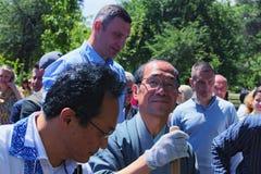 Mayor of Kiev Vitali Klitschko and Mayor of Kyoto Daisaku Kadokawa are planting an sakura tree. Royalty Free Stock Images