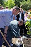 Mayor of Kiev Vitali Klitschko and Mayor of Kyoto Daisaku Kadokawa are planting an sakura tree. Royalty Free Stock Photo
