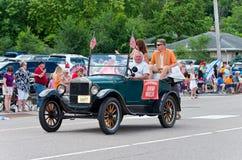 Mayor in Motorcade at Mendota Days Parade. Mendota, Minnesota, USA – JULY 8, 2017: The Mayor of Mendota rides in motorcade through main street of the historic Stock Photos