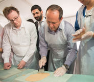 Mayor Nir Barkat At A matzah baking workshop. Sponsored by Jerusalem City Hall. The event is taking place at Safra Square and intend to bring the tradition of Stock Images