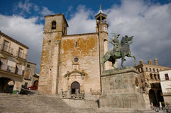 Mayor Square in Trujillo. Caceres, Spain. Statue of Francisco Pizarro (Spanish explorer and conqueror of Peru) and the Church of St. Martin in Mayor Square of Royalty Free Stock Photo