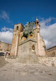 Mayor Square in Trujillo. Caceres, Spain. Statue of Francisco Pizarro (Spanish explorer and conqueror of Peru) and the Church of St. Martin in Mayor Square of Royalty Free Stock Image
