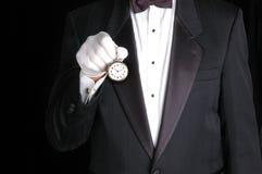 Mayordomo con el reloj Fotografía de archivo libre de regalías