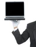 Mayordomo con la computadora portátil en la mano Imágenes de archivo libres de regalías