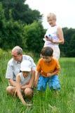 Mayores con los nietos Fotografía de archivo libre de regalías