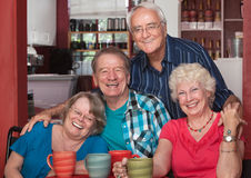 Mayores de risa en café Imagen de archivo libre de regalías