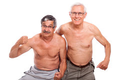 Mayores descubiertos felices que muestran la carrocería Fotografía de archivo