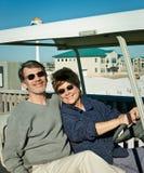Mayores en Golfcart en la playa Imágenes de archivo libres de regalías