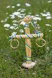 Maypole decoration in the grass amoung the daisy flowers Royalty Free Stock Photo