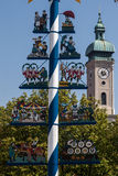 Maypole and Heilig Geist church Munich Germany Royalty Free Stock Photos