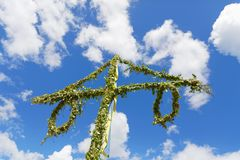 Maypole made of green leaf and the blue sky and some white cloud Stock Photography