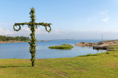 Maypole and the swedish archipelago in the background Stock Images