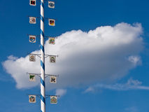 Maypole and white cloud. Maypole from bavaria in front of a white cloud Stock Photos