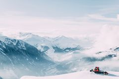 Winter mountain landscape with snow grooming machine. MAYRHOFEN, AUSTRIA - FEBRUARY 19, 2018: Winter mountain landscape with snow grooming machine stock photos