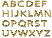 Mayúsculas del alfabeto brillante del oro Imagenes de archivo