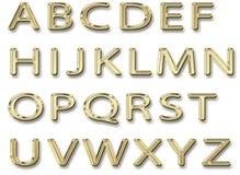 Mayúsculas del alfabeto brillante del oro Imagen de archivo