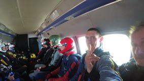 Group of skydivers sits inside a small plane awaiting a jump. Mayskoe, Dnepr, Oktober 14, 2018: Group of skydivers sits inside a small plane awaiting a jump stock footage