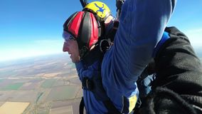 Skydivers flying in tandem under the open parachute. MAYSKOE, DNEPR, OKTOBER 14, 2018: Skydivers flying in tandem under the open parachute. Tandem Skydiving stock video