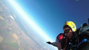 Skydivers jumping in tandem out of an airplane. Slow motion. Mayskoe, Dnepr, Oktober 14, 2018: Skydivers Jumping in Tandem out of an Airplane. Skydiving. Tandem stock footage