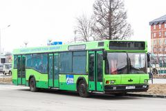 MAZ 103. Novyy Urengoy, Russia - May 9, 2015: Green city bus MAZ 103 in the city street stock image