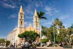Mazatlan Cathedral. Yellow spires of old town Mazatlan`s cathedral sparkle against an azure blue sky Stock Photography