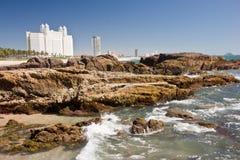 Mazatlan Seaside. Modern high-rise hotels behind seaside rocks and the Pacific Ocean royalty free stock image