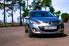 Mazda демiо мay 2014 years border with China. A new Mazda 2 on a country road. The Mazda 2 is a supermini vehicle manufactured by Mazda, a Japanese Royalty Free Stock Photography