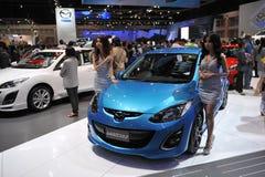 Mazda 2 no indicador em uma mostra de motor Imagem de Stock Royalty Free