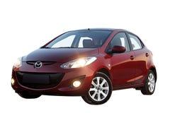 Mazda 2 auto die op witte achtergrond wordt geïsoleerd Stock Afbeeldingen