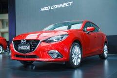 Mazda 3 bil på skärm Arkivbild