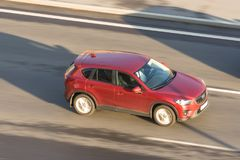 Mazda Crossover red rides the highway. Russia. Saint-Petersburg. 06 july 2018. Mazda Crossover red rides the highway. Russia. Saint-Petersburg. 06 july 2018 Stock Photo