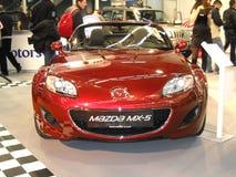 Mazda MX-5 car on Belgrade car show. BELGRADE, SERBIA - MARCH 08: Front view of Mazda MX-5 car on Belgrade car show, March 08, 2010 in Belgrade, Serbia stock illustration