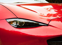 Mazda MX 5 Sport Recaro 2016. The Frontal right side of a red Mazda MX 5 Sport Recaro car, limited edition, focus on the headlight Stock Images