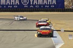 Mazda RX-8 GT in flames @ Grand AM Rolex Races. Mazda RX8, Dodge Viper GTS, Ferrari F458, Corvette Can-Am,  Grand AM Rolex Races, Mazda Raceway Laguna Seca Stock Images