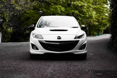 Mazda sedan on country road Royalty Free Stock Image