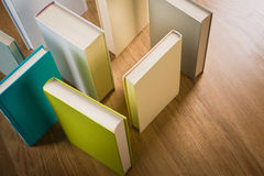 Maze of books. Standing books on floor composing a maze, learning and thinking concept royalty free stock image