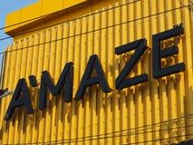 A`maze brand name and logo. BANGKOK, THAILAND - DECEMBER 22, 2018: A`maze brand name and logo on corrugated yellow facade on December 22, 2018 in Bangkok royalty free stock photo