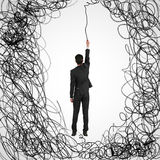 Maze and business challenge concept. Man hanging on abstract scribbled rope. Maze and business challenge concept Royalty Free Stock Photos