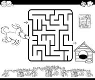 Maze with dog and kennel coloring page Royalty Free Stock Image