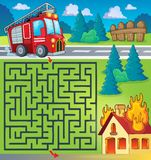 Maze 3 with fire truck theme. Eps10 vector illustration Stock Image