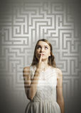 Maze. Girl in white solving a problem. Royalty Free Stock Photo